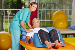 elderly man having a physical therapy
