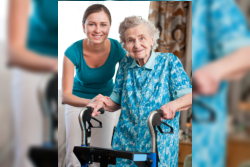 elderly woman being supported by her caregiver
